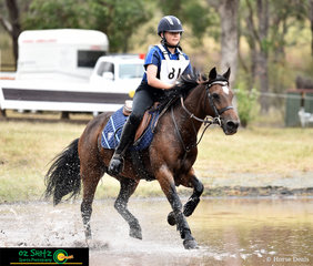 Tess Mison and Ginny blaze through the water complex at the Sydney International Equestrian Centre.