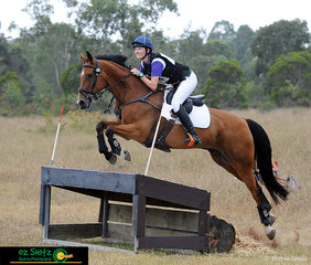 Soaring over the Farm House during the One Star at NSW State Interschool Championships was Willa Mitchell riding her horse Taurus.