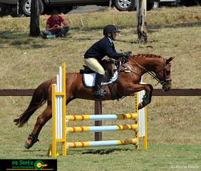 It was high knees for Allengreen Gift as Zachary Irwin navigates their way around the EvA80 show jumping phase.