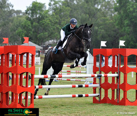 Without letting the rain get to them, Brianna Pecanac and BHM Black Galliano show great form over the oxer in their 105cm Show Jumping phase of the Combined Training.