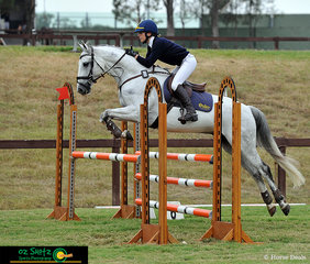 The grey Blurred Lines was not touching those rails! Anneliese Wansey jumps a beautiful clear round on her second ride in the 105cm Combined Training Show Jumping Phase.