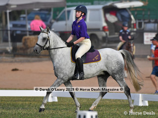 "Smamantha Kelleher representing St Arnuad in the Grade 4 Dressage riding ""Tuppal Remington"" her team ""Purple Stars"""