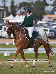 "Clancy Lyons in the Grade 1 Dressge riding ""Kilcorran Cash Towulun"" representing her team ""Midura's Mane Attraction"""
