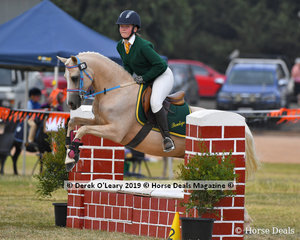 "Pru Robinson from Bendigo rode ""Atsbury Gold Class"" in the E Grade Showjumping representing her team ""The Barbie Ponies"""