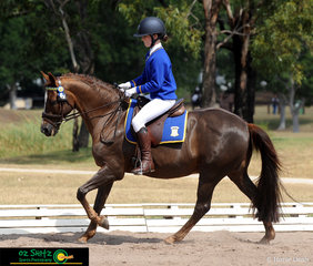 Working down the long side of the arena was Claudia Smith and Little Paddocks Mikado in the Primary Preliminary dressage on the third day of the NSW Interschool State Championships. .
