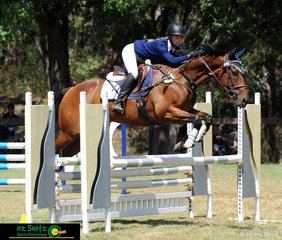 Looking ahead to the next jump is Tara Wilson and her horse Bee Stinger as they ride in a competitive secondary field for the 90cm.