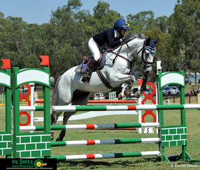 In the hotly contested 1.20m Show Jumping, Anneliese Wansey and Blurred Lines clear the final fence.