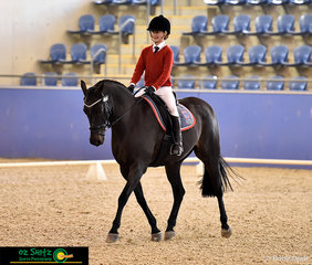 With a beaming smile, Angelina Thompson and Naaman Protege make their way down the centre line to conclude their Primary Novice test on the second last day of competition..