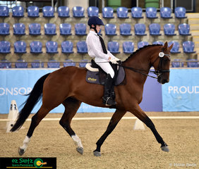Representing Oxley College in the Secondary Medium is Year Eleven student Hunter Taylor riding Maybelle Matilda.