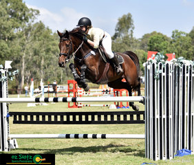 Against the clock on the fourth day of competition in the 1.20m is Emily Moore riding Atomix Citation.