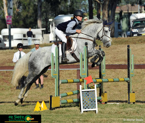 Eighteen Carrot has no trouble with the oxer in the 80cm Secondary two phase Show Jumping round with rider Alexandra Fairfield-Smith who represents Snowy Mountains Grammar School. .