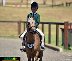 Presenting to the judge as they prepare to begin their workout in the Primary Show Horse is Year 6 student, Jett Newman and Swanreach Gold Charm.