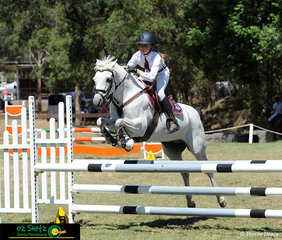 Maddie Breatnach and her pony Good Scout head to the finish line in the Secondary 90cm Two Phase Show Jumping on the final day of the NSW Interschool State Championships held at the Sydney International Equestrian Centre..