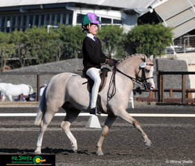 Working out for the Judge in the Show Hunter Secondary class on the final day of the NSW Interschool Championships is Elizabeth Taylor and Kenda Park Strauss - Elizabeth's second ride in this class.
