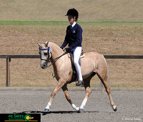 Impressing the judge with a great test in the Working Hunter Secondary class is Abbey Lonsdale and Elmridge Roxy.