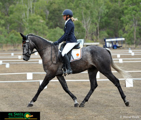 Trotting up the centreline in the dressage phase of the EvA60 is Belrock Sebi with Nicole Johnson in the saddle.