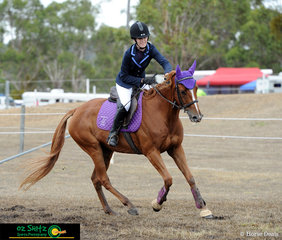 Happy with her round, Isabella Ennever gives Tommy Tails a pat at the end of the EvA60 show jumping phase..