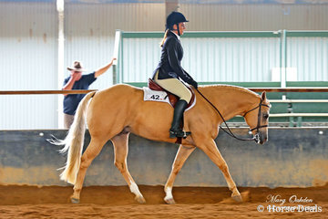 Youth rider, Brianna Miller puts So Good To Be Cool through his paces in Sunday's Youth 13 to 17 Years Hunter Under Saddle.