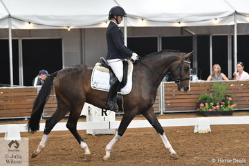 Justine Greer produced a nice test riding Bronwyn Shortt's, Desert Sands Isle of D Bling for seventh place in the 4 year old young horse class.