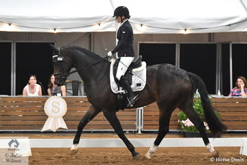 Dani'elle Walliss rode Jenny Stock's, Karizmah Leroy Brown to ninth place in the 4 year old young horse class.