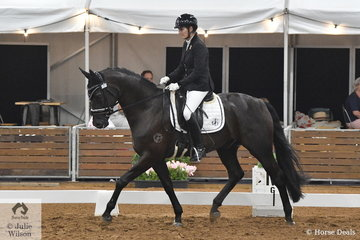 Karen Blythe rode her Stedinger gelding, Sonic K to second place scoring 78.2 in the 4 year old young horse round one.