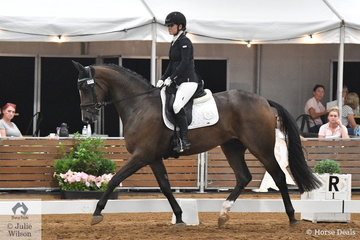 Dani'elle Walliss rode Jenny Stock's, Karizmah Buzz Lightyear to equal fourth place in the tough class for 4 year old young horses.