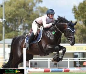 Riding in the 1.25m - 1.30m class on the second day of Warwick Show was Brooke Langbecker and Black Jack.