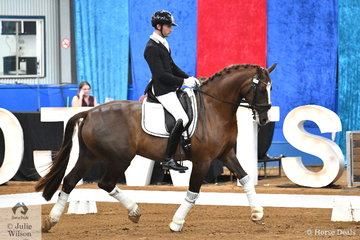 The Lauren George Family Trust nomination,  'Bertone' by Benicio, ridden by Jayden Brown from Queensland took out the Six Year Old Young Dressage Horse Championship.