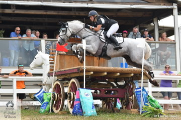 Chelsea Priestley and 'Skansen Purist' make a lovely jump in front  of the Wandin clubrooms during their Pryde's CCI4* cross country run.