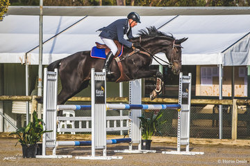 The perennial and long time member of the Border District Show Jump Club, Marcus McMaugh and Tulara Stolle from Barnawatha in NE Victoria looking good over the Kiahglen Show Jumping Supplies fence in the 105cm class