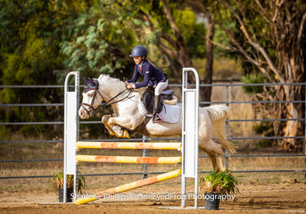 Sienna Holdsworth-Rose and her pony Calypso enjoying their round to place 1st in the 95cm Pony