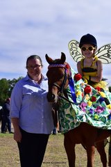 Isabel Pearce and her pony Kiabe Banksia Rose, led by Lucy Pearce, won the Fancy Dress class for their bee and flower costume.