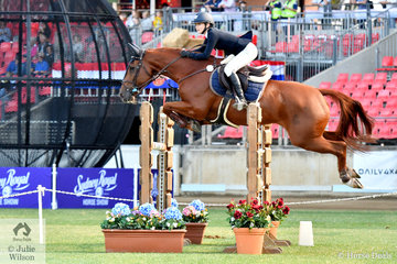 Tess McInerney makes a super jump aboard her, 'Alpha Centauri' on their way to winning the Young Rider Table C on day one of the 2019 Sydney Royal Easter Show.