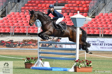 Emily Baldwin and 'Twins Ava' are pictured on their way to victory in the Junior Jump Off class this morning.