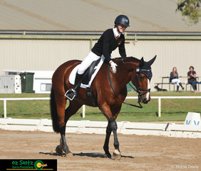 Big smiles for Hannah Bird and big pats for Kirby Park Irish Consort after the completion of the Senior Novice Dressage test at the 2019 Victorian Interschool State Championships.