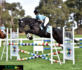 Showing everyone how it's done in the 95cm Combined Training Secondary class on day two of the Victorian Interschool State Championships is year 11 Geelong Grammar School student, Sidney White riding 8 year old Irish Sport Horse, KD Dastan.