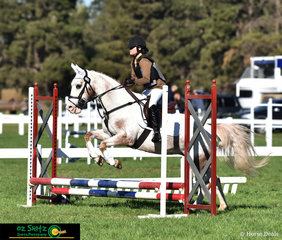 Having some fun in the 45cm Jump Off round on the third day of the 2019 Victorian Interschool State Championships was Eleanor Shephard and she rode her  horse, Mystyque.