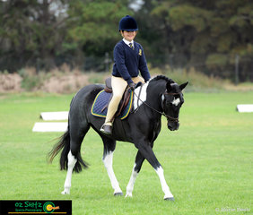 Emma Wilkinson from Westbourne Grammar School competes her black and white pinto, Giggles in the Primary Working Hunter class at the 2019 Victorian Interschool State Championships.