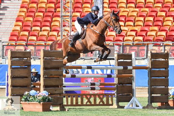 Natalie Mohr and 'Talbot Cece' are pictured making a good jump during the Young Rider Grand Prix today.