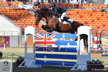 Amber Fuller is pictured aboard the Mt Australia Investments P/L nomination, 'CP Aretino' making a lovely jump over the planks on their way to second place in the Section 1 Jump Off class.