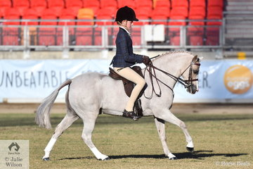 Elizabeth Taylor is pictured during the Small Show Hunter Pony Championship ride off aboard her, 11.2-12hh winner, 'Kenda Park Strauss'.