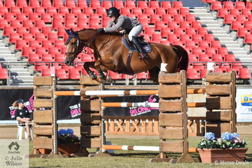 Tallara Cameron is pictured aboard her scopey, 'Come By Chance' during the Part Three jump off class this morning.