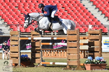 Busy jumping rider, James Arkins is pictured aboard his own and Donna Peulic's nomination, 'WP Grandiamo' during the Part Three jump off class this morning.