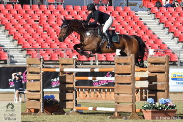 Steph Davies is pictured aboard her, 'Chekin Charlie' making a super jump during the Section Three jump off class this morning.