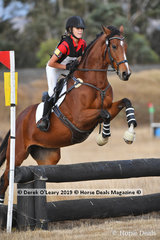 "Winner of the Pony Club Grade 3, Aishah Robertson riding ""Jarss Dealer"" with a winning score of 31"