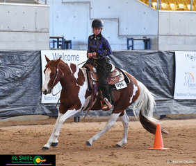 With a look of determination, Amber Lewis and Wayouts Ima Royal QT compete in the Youth Western Riding on the last day of the 2019 Paint Horse National Championships