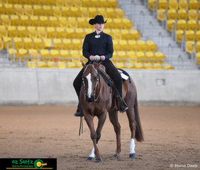 Showing a nice cross over in the Amateur Western Equitation is Jacqui Yarlett riding Whisper A Tribute.