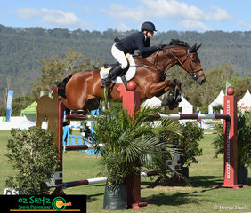 Making their way through the troublesome treble in the 1.50m Grand Prix is Amber Fuller and CP Aretino