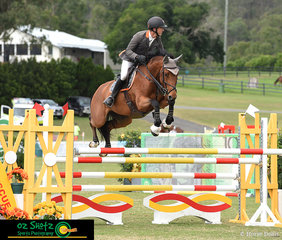 Shane Davidson and Jaybee Vision give the triple bar plenty of room in the jump off for the 6 Year Old class at the Aquis Champions Tour