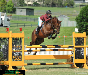 Clearing each fence in the 5 Year Old Horse Finals was Jess Brown aboard Equus Archer at the 2019 AQUIS Champions Tour.